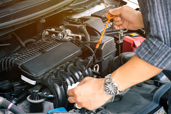 An image of a car having its oil checked.
