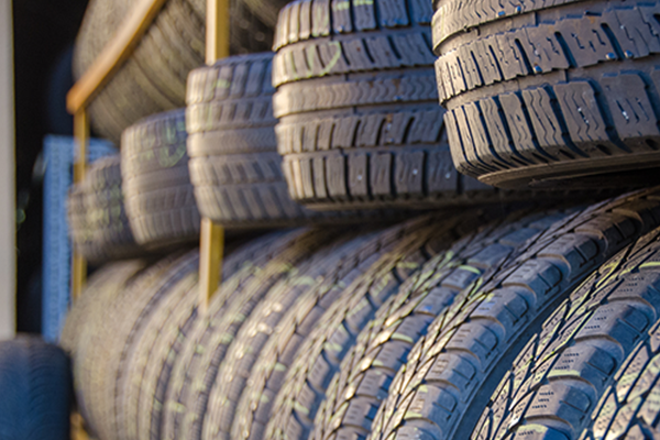 An image showing a bunch of stored tyres.